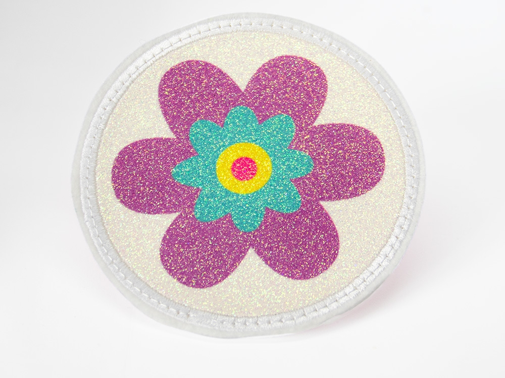 Glitzerbutton lila Blume